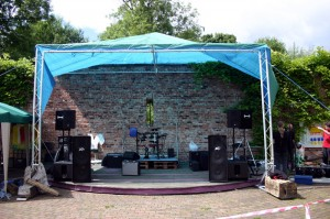 An empty stage showing sound and speaker set up