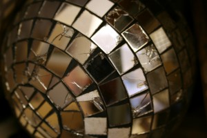 Close up photograph of a disco mirror ball