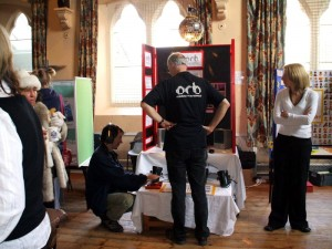 People stood looking at Orb's stand at a World Mental Health Day event